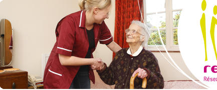 pregnant carer helps her elderly pacient to her fe
